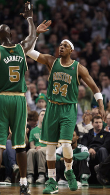 BOSTON, MA - MARCH 16:  Paul Pierce #34 of the Boston Celtics is congratulated by teammate Kevin Garnett #5 after Pierce drew the foul in the second half against the Indiana Pacers on March 16, 2011 at the TD Garden in Boston, Massachusetts. The Celtics d