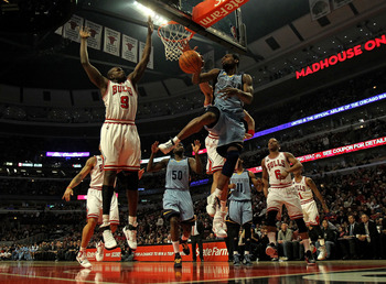 CHICAGO, IL - MARCH 25: Tony Allen #9 of the Memphis Grizzlies passes the ball around Loul Deng #9 of the Chicago Bulls at the United Center on March 25, 2011 in Chicago, Illinois. The Bulls defeated the Grizzlies 99-96. NOTE TO USER: User expressly ackno