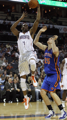 CHARLOTTE, NC - NOVEMBER 24:  Timofey Mozgov #25 of the New York Knicks tries to stop Derrick Brown #4 of the Charlotte Bobcats during their game at Time Warner Cable Arena on November 24, 2010 in Charlotte, North Carolina.  NOTE TO USER: User expressly a