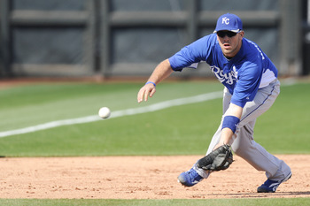 SURPISE, AZ - FEBRUARY 27: Mike Moustakas #8 of the Kansas City Royals field a ground ball during a spring training game against the Texas Rangers at Surprise Stadium on February 27, 2011 in Surprise, Arizona. (Photo by Rob Tringali/Getty Images)