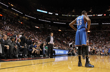 MIAMI, FL - MARCH 16:  Kevin Durant #35 of the Oklahoma City Thunder looks on with head coach Scott Brooks during a game against the Miami Heat at American Airlines Arena on March 16, 2011 in Miami, Florida. NOTE TO USER: User expressly acknowledges and a