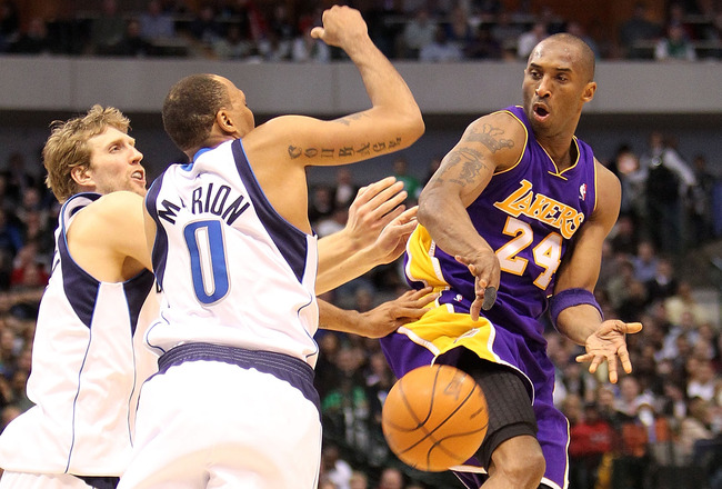 DALLAS - FEBRUARY 24:  Kobe Bryant #24 of the Los Angeles Lakers passes against Dirk Nowitzki #41 and Shawn Marion #0 of the Dallas Mavericks on February 24, 2010 at American Airlines Center in Dallas, Texas.  NOTE TO USER: User expressly acknowledges and