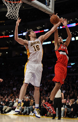 LOS ANGELES, CA - MARCH 20:  Pau Gasol #16 of the Los Angeles Lakers and Nicolas Batum #88 of the Portland Trail Blazers jump for a rebound at the Staples Center on March 20, 2011 in Los Angeles, California.  NOTE TO USER: User expressly acknowledges and