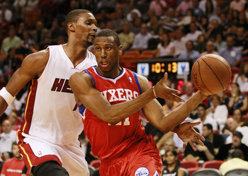 MIAMI, FL - MARCH 25:  Forward Thaddeus Young #21 of the Philadelphia Sixers drives against Forward Chris Bosh #1 of the Miami Heat at American Airlines Arena on March 25, 2011 in Miami, Florida. The Heat defeated the Sixers 111-99. NOTE TO USER: User exp