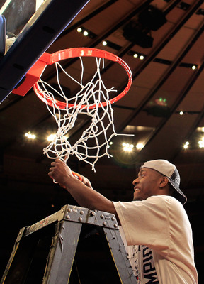 NEW YORK, NY - MARCH 12:  Kemba Walker #15 of the Connecticut Huskies cuts down the net after defeating the Louisville Cardinals during the championship of the 2011 Big East Men's Basketball Tournament presented by American Eagle Outfitters at Madison Squ