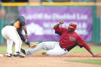 SCOTTSDALE, AZ - FEBRUARY 25: Justin Upton #10 of the Arizona Diamondbacks is tagged out at second base by Miguel Tejada #10 San Francisco Giant at Scottsdale Stadium on February 25, 2011 in Scottsdale, Arizona. (Photo by Rob Tringali/Getty Images)