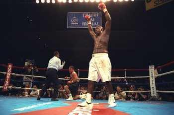 22 Jul 1996: Buster Douglas celebrates after knocking down Tony La Rosa during the Buster Douglas v Tony La Rosa fight at the Trump Taj Mahal in Atlantic City, New Jersey. Douglas won the fight fight in the third round by TKO.