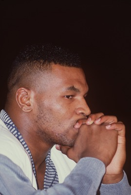 25 FEB 1989:  CHAMPION MIKE TYSON LOOKS PENSIVE AS HE RESTS HIS CHIN IN HIS HANDS IN THIS PORTRAIT TAKEN DURING THE PRESS CONFERENCE BEFORE HIS HEAVYWEIGHT CHAMPIONSHIP FIGHT AGAINST CHALLENGER FRANK BRUNO OF GREAT BRITAIN AT THE HILTON IN LAS VEGAS. Mand