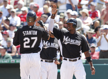 JUPITER, FL - MARCH 24: Mike Stanton #27 is congratulated by Hanley Ramirez #2 of the Florida Marlins after hitting a three run home run against the Boston Red Sox at Roger Dean Stadium on March 24, 2011 in Jupiter, Florida. (Photo by Joel Auerbach/Getty