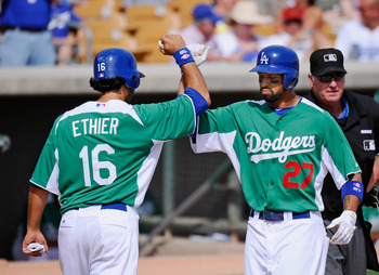 GLENDALE, AZ - MARCH 17: Matt Kemp #27 and Andre Eithier #16 of the Los Angeles Dodgers wearing a green jersey in celebration of St. Patrick's Day high five after Kemp hit a two run home run against the Arizona Diamondbacks during the spring training base