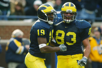 ANN ARBOR, MI - NOVEMBER 2:  Ronald Bellamy #19 of the Michigan Wolverines celebrates with Bennie Joppru #83 after Bellamy caught his second touchdown pass of the day against the Michigan State Spartans on November 2, 2002 at Michigan Stadium in Ann Arbor