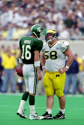 9 Oct 1999: Quarterback Bill Burke #16 of the Michigan State Spartans confronts Rob Renes #58 of the Michigan Wolverines at the Spartan Stadium in East Lansing, Michigan. The Spartans defeated the Wolverines 31-34. Mandatory Credit: Donald Miralle  /Allsp