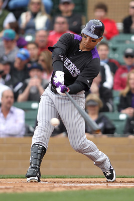 SCOTTSDALE, AZ - FEBRUARY 26:  Carlos Gonzalez #5 of the Colorado Rockies swings during the game against the Arizona Diamondbacks at Salt River Fields on February 26, 2011in Scottsdale, Arizona..  (Photo by Jonathan Ferrey/Getty Images)