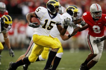COLUMBUS, OH - NOVEMBER 18:  Wide receiver Steve Breaston #15 of the Michigan Wolverines runs with the ball against the Ohio State Buckeyes on November 18, 2006 at Ohio Stadium in Columbus, Ohio.  Ohio State won 42-39.  (Photo by Gregory Shamus/Getty Imag