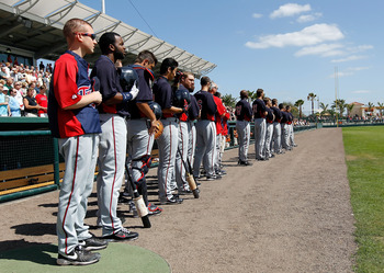 SARASOTA, FL - MARCH 03:  The Minnesota Twins line up for the National Anthem just before the start of the Grapefruit League Spring Training Game against the Baltimore Orioles at Ed Smith Stadium on March 3, 2011 in Sarasota, Florida.  (Photo by J. Meric/