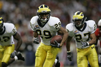 SAN ANTONIO - DECEMBER 28:  Cornerback Leon Hall #29 of the Michigan Wolverines returns an interception against the Nebraska Cornhuskers during the MasterCard Alamo Bowl on December 28, 2005 at the Alamodome in San Antonio, Texas.  The Huskers won 32-28.