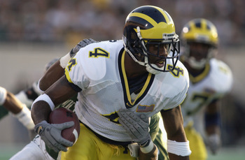 EAST LANSING, MI - NOVEMBER 3:  Wide receiver Marquise Walker #4 of the Michigan Wolverines runs with the ball during the Big Ten Conference football game against the Michigan State Spartans on November 3, 2001 at Spartan Stadium in East Lansing, Michigan