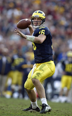 PASADENA, CA - JANUARY 1:  Quarterback John Navarre #16 of the Michigan Wolverines sets to throw the ball during the 2004 Rose Bowl game against the USC Trojans on January 1, 2004 at the Rose Bowl in Pasadena, California.  USC defeated Michigan 28-14.  (P