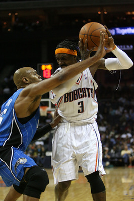 CHARLOTTE, NC - NOVEMBER 10:  Vince Carter #15 of the Orlando Magic guards Gerald Wallace #3 of the Charlotte Bobcats during their game at Time Warner Cable Arena on November 10, 2009 in Charlotte, North Carolina.  (Photo by Streeter Lecka/Getty Images)