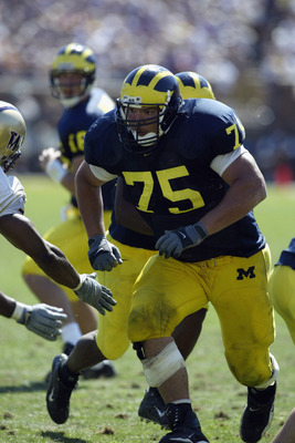 ANN ARBOR, MI - AUGUST 31:  Offensive linebacker David Baas #75 of Michigan runs after the snap during the NCAA football game against the Washington Huskies at Michigan Stadium in Ann Arbor, Michigan on August 31, 2002. The Michigan Wolverines won on a la