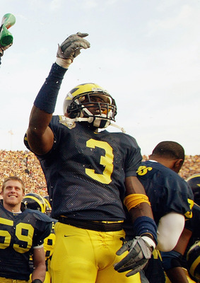 ANN ARBOR, MI - NOVEMBER 22:  Wide receiver Ross Kesler #22 and Marlin Jackson #3 of the Michigan Wolverines celebrate on the sideline during the game against the Ohio State Buckeyes during the 100th meeting of the two teams November 22, 2003 at Michigan