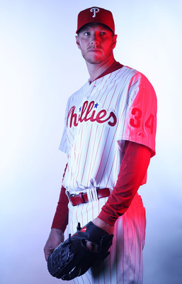 CLEARWATER, FL - FEBRUARY 22:  (EDITORS NOTE: Image was shot with a colored gel on lights) Roy Halladay #34 of the Philadelphia Phillies poses for a photo during Spring Training Media Photo Day at Bright House Networks Field on February 22, 2011 in Clearw