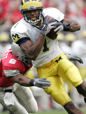 COLUMBUS, OH - NOVEMBER 20:  Wide receiver Braylon Edwards #1 of the Michigan Wolverines runs with a catch against safety Tyler Everett #6 of the Ohio State Buckeyes during the third quarter on November 20, 2004 at Ohio Stadium in Columbus, Ohio. Ohio Sta