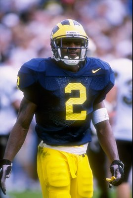 13 Sep 1997: Cornerback Charles Woodson of the Michigan Wolverines stands on the field during a game against the Colorado Buffaloes at Michigan Stadium in Ann Arbor, Michigan. Michigan won the game 27-3.
