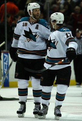 ANAHEIM, CA - DECEMBER 16:  Joe Thornton #19 of the San Jose Sharks celebrates with teammates Torrey Mitchell #17 after scoring the game winning goal in a shoot out against the Anaheim Ducks during the NHL game at Honda Center on December 16, 2007 in Anah