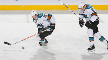 BUFFALO, NY - DECEMBER 09: Torrey Mitchell #17 and Joe Pavelski #8 of the San Jose Sharks skate against the Buffalo Sabres at HSBC Arena on December 9, 2010 in Buffalo, New York.  (Photo by Rick Stewart/Getty Images)