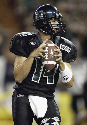 HONOLULU, HI - NOVEMBER 6:  University of Hawaii quarterback Timmy Chang looks to pass during the game between University of Hawaii and Louisiana Tech University at Aloha Stadium, November 6, 2004 in Honolulu, Hawaii. (Photo by Marco Garcia/Getty Images)
