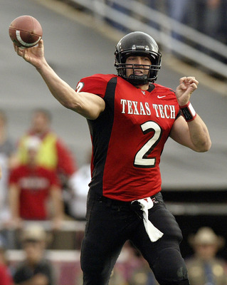LUBBOCK, TX -NOVEMBER 22:  Quarterback B.J. Symons #2 of the Texas Tech Red Raiders drops back to pass against the Oklahoma Sooners on November 22, 2003 at Jones SBC Stadium in Lubbock, Texas.  (Photo by Ronald Martinez/Getty Images)