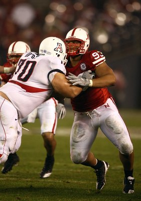 SAN DIEGO - DECEMBER 30:  Ndamukong Suh #93 of the University of Nebraska Cornhuskers engages an offensive lineman in a block during the Pacific Life Holiday Bowl against University of Arizona Wildcats on December 30, 2009 at Qualcomm Stadium in San Diego