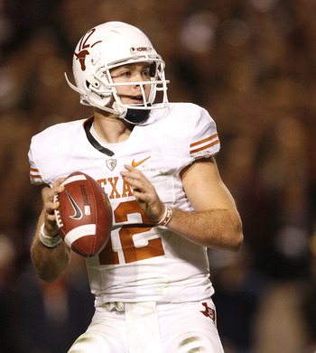 COLLEGE STATION, TX - NOVEMBER 26: Quarterback Colt McCoy #12 of the Texas Longhorns looks to pass the ball downfield against the Texas A&M Aggies in the second half at Kyle Field on November 26, 2009 in College Station, Texas. The Longhorns defeated the