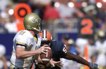 26 Aug 2001: Quarterback George Godsey #11 of Georgia Tech looks to pass as defensive end Dwight Freeney #54 closes in during the Kickoff Classic against Syracuse at Giants Stadium in East Rutherford, New Jersey.   Georgia Tech won 13-7.  DIGITAL IMAGE Ma