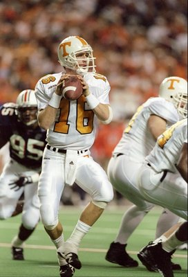6 Dec 1997: Quarterback Peyton Manning #16 of Tennessee drops back to pass during the Volunteers 30-29 win over Auburn in the SEC Championship at the Georgia Dome in Atlanta, Georgia.