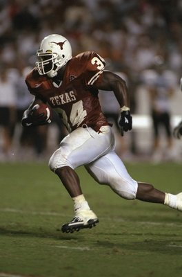 26 Sep 1998:  Running back Ricky Williams #34 of the Texas Longhorns in action during the game against the Rice Owls at the Texas Memorial Stadium in Austin, Texas. The Longhorns defeated the Owls 59-21. Mandatory Credit: Chris Covatta  /Allsport