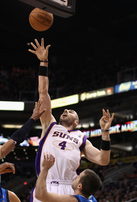 PHOENIX, AZ - MARCH 27:  Marcin Gortat #4 of the Phoenix Suns puts up a shot against the Dallas Mavericks during the NBA game at US Airways Center on March 27, 2011 in Phoenix, Arizona. The Mavericks defeated the Suns 91-83. NOTE TO USER: User expressly a