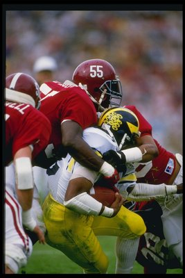 Linebacker Derrick Thomas of the Alabama Crimson Tide makes a tackle during a game against the Michigan Wolverines at Byrant Denny Stadium in Tuscawosa, Alabama.
