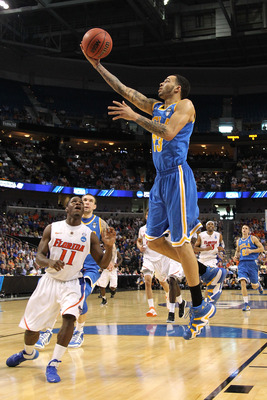 TAMPA, FL - MARCH 19:  Tyler Honeycutt #23 of the UCLA Bruins drives for a shot attempt against Erving Walker #11 of the Florida Gators during the third round of the 2011 NCAA men's basketball tournament at St. Pete Times Forum on March 19, 2011 in Tampa,