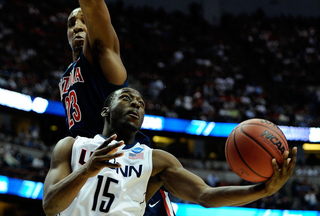 ANAHEIM, CA - MARCH 26:  Kemba Walker #15 of the Connecticut Huskies goes to the basket Derrick Williams #23 of the Arizona Wildcats during the west regional final of the 2011 NCAA men's basketball tournament at the Honda Center on March 26, 2011 in Anahe