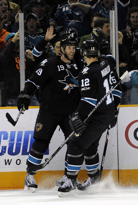 SAN JOSE, CA - DECEMBER 23: Joe Thornton #19 of the San Jose Sharks after scoring a goal celebrates with teammates Patrick Marleau #12 and Dany Heatley #15 against the Phoenix Coyotes during an NHL hockey game at the HP Pavilion on December 23, 2010 in Sa