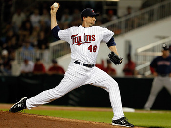 FORT MYERS, FL - FEBRUARY 27:  Pitcher Carl Pavano #48 of the Minnesota Twins pitches against the Boston Red Sox during a Grapefruit League Spring Training Game at Hammond Stadium on February 27, 2011 in Fort Myers, Florida.  (Photo by J. Meric/Getty Imag