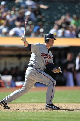 OAKLAND, CA - JUNE 06:  Justin Morneau #33 of the Minnesota Twins bats against the Oakland Athletics during an MLB game at the Oakland-Alameda County Coliseum on June 6, 2010 in Oakland, California.  (Photo by Jed Jacobsohn/Getty Images)