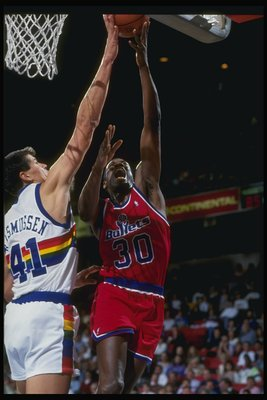 1990-1991:  Forward Bernard King of the Washington Bullets (right) goes up against center Blair Rasmussen of the Denver Nuggets during a game at the McNichols Arena in Denver Colorado. Mandatory Credit: Tim de Frisco  /Allsport