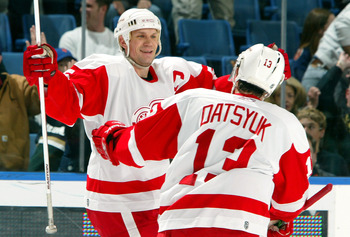 UNIONDALE, NY - JANUARY 30:  Nicklas Lidstrom #5 of the Detroit Red Wings celebrates with Pavel Datsyuk #13 after assisting on teammate Henrik Zetterberg's (not pictured) overtime goal against the New York Islanders on January 30, 2007 at Nassau Coliseum