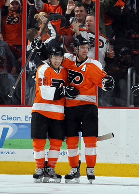PHILADELPHIA, PA - FEBRUARY 05:  Jeff Carter #17 of the Philadelphia Flyers celebrates his goal against the Dallas Stars with teammate Claude Giroux #28 on February 5, 2011 at Wells Fargo Center in Philadelphia, Pennsylvania. The Flyers defeated the Stars