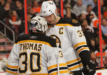 PHILADELPHIA, PA - DECEMBER 01:  Tim Thomas #30 of the Boston Bruins talks with Zdeno Chara #33 against the Philadelphia Flyers at the Wells Fargo Center on December 1, 2010 in Philadelphia, Pennsylvania.  (Photo by Nick Laham/Getty Images)