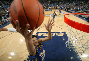MEMPHIS, TN - MARCH 14: Jerome Jordan #23 of the Tulsa Golden Hurricane drives to the basket in a game against the Memphis Tigers during the Championship of the Conference USA Basketball Tournament at FedExForum on March 14, 2009 in Memphis, Tennessee. (P