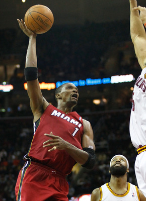 CLEVELAND - MARCH 29: Chris Bosh #1 of the Miami Heat attempts a shot during the game against the Cleveland Cavaliers on March 29, 2011 at Quicken Loans Arena in Cleveland, Ohio. NOTE TO USER: User expressly acknowledges and agrees that, by downloading an